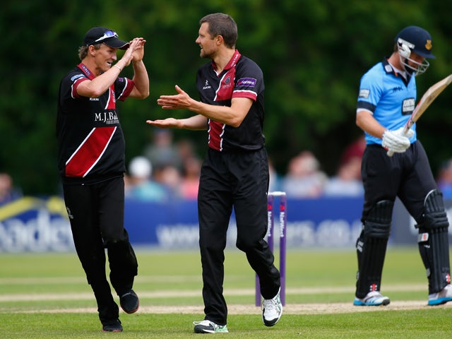 Dirk Nannes of Somerset celebrates with teammate Max Waller after dismissing Chris Nash of Sussex during the Natwest T20 Blast match between Sussex Sharks and Somerset at Arundel Castle on June 15, 2014