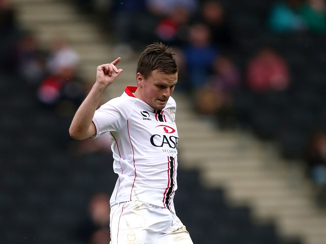 Stephen Gleeson of MK Dons in action during the Sky Bet League One match between MK Dons and Brentford at Stadium mk on April 21, 2014