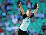 Tom Curran of Surrey celebrates taking the wicket of Luke Wright of Sussex during the Natwest T20 Blast match between Surrey and Sussex Sharks at The Kia Oval on June 13, 2014
