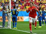 Switzerland's forward Admir Mehmedi celebrates after scoring during a Group E football match between Switzerland and Ecuador at the Mane Garrincha National Stadium in Brasilia during the 2014 FIFA World Cup on June 15, 2014