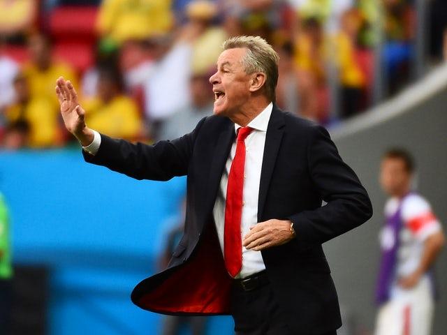 Switzerland's German coach Ottmar Hitzfeld gestures during a Group E football match between Switzerland and Ecuador at the Mane Garrincha National Stadium in Brasilia during the 2014 FIFA World Cup on June 15, 2014