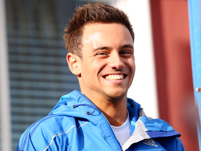 British diver Tom Daley speaks to the media as the Commonwealth Games Baton arrives at St Aubins Harbour on May 11, 2014