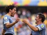 Uruguay's forward Edinson Cavani celebrates with his teammate Uruguay's midfielder Cristian Rodriguez after scoring during a Group D football match between Uruguay and Costa Rica at the Castelao Stadium in Fortaleza during the 2014 FIFA World Cup on June