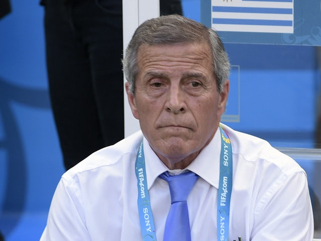 Uruguay's coach Oscar Tabarez sits on the bench during a Group D football match between Uruguay and Costa Rica at the Castelao Stadium in Fortaleza during the 2014 FIFA World Cup on June 14, 2014