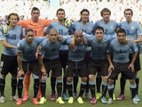 Players of Uruguay pose for a team picture prior to a Group D football match between Uruguay and Costa Rica at the Castelao Stadium in Fortaleza during the 2014 FIFA World Cup on June 14, 2014