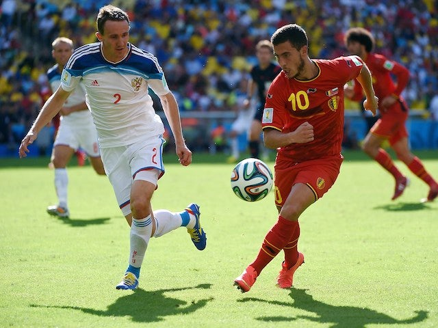 Russia's defender Aleksei Kozlov and Belgium's midfielder Eden Hazard vie for the ball during a Group H football match on June 22, 2014