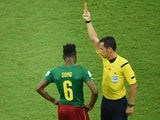 Cameroon's Alex Song is shown a red card during his team's match with Croatia on June 18, 2014.