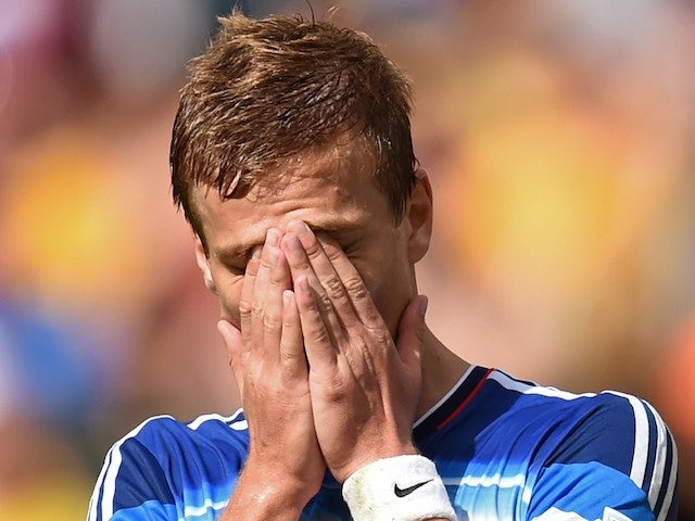Russia's forward Alexander Kokorin reacts after missing a shot during a Group H football match against Belgium on June 22, 2014