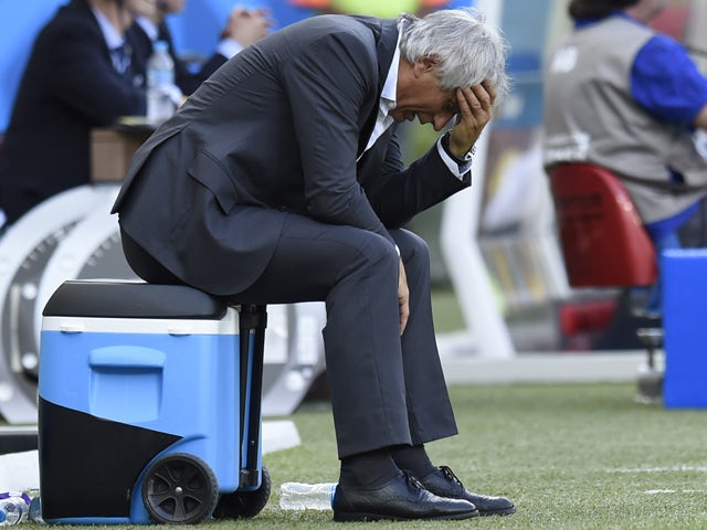 Algeria's Bosnian coach Vahid Halilhodzic gestures after his team lost 1-2 during the Group H football match between Belgium and Algeria at the Mineirao Stadium in Belo Horizonte during the 2014 FIFA World Cup on June 17, 2014