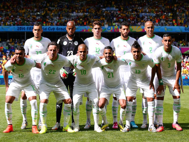 Algeria players pose for a team photo before the 2014 FIFA World Cup Brazil Group H match between Belgium and Algeria at Estadio Mineirao on June 17, 2014