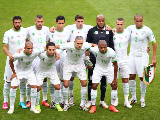 Algeria players pose for a team photo prior to the 2014 FIFA World Cup Brazil Group H match between South Korea and Algeria at Estadio Beira-Rio on June 22, 2014