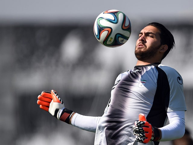 Iran's goalkeeper Alireza Haghighi takes part in a training session at the CT Joaquim Grava training ground in Sao Paulo on June 18, 2014