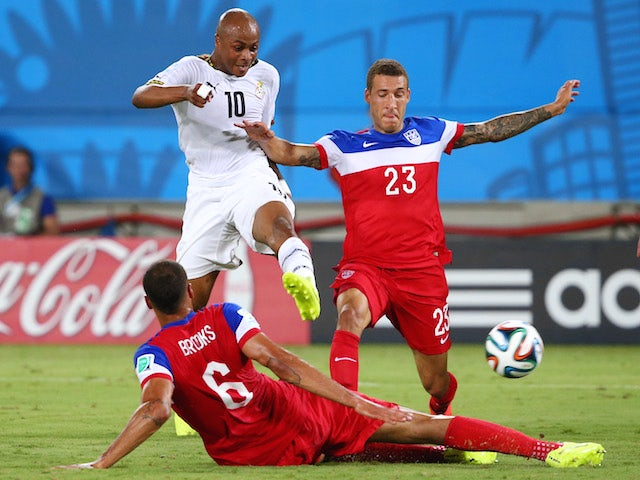 Andre Ayew of Ghana shoots and scores his team's first goal past John Brooks and Fabian Johnson of the United States (R) during the 2014 FIFA World Cup Brazil Group G match on June 17, 2014