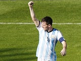 Argentina's forward and captain Lionel Messi celebrates scoring during the Group F football match between Argentina and Iran at the Mineirao Stadium in Belo Horizonte during the 2014 FIFA World Cup in Brazil on June 21, 2014