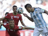 Iran's defender Jalal Hosseini and Argentina's forward Sergio Aguero vie for the ball during the Group F football match between Argentina and Iran at the Mineirao Stadium in Belo Horizonte during the 2014 FIFA World Cup in Brazil on June 21, 201