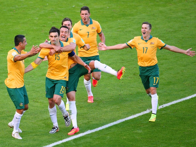 Mile Jedinak of Australia celebrates scoring his team's second goal with teammates during the 2014 FIFA World Cup Brazil Group B match between Australia and Netherlands at Estadio Beira-Rio on June 18, 2014