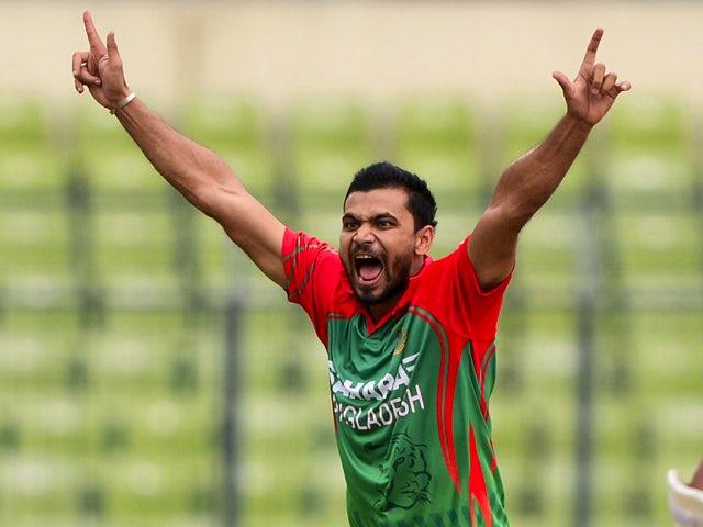 Bangladeshi cricketer Mashrafe Bin Mortaza successfully appeals for a leg before wicket decision against Indian cricketer Ajinkya Rahane during the second One Day International (ODI) cricket match between India and Bangladesh at the Sher-e-Bangla National