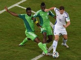 Bosnia-Hercegovina's forward Edin Dzeko fights for the ball with Nigeria's defender Joseph Yobo and Nigeria's defender Kenneth Omeruo during the Group F football match between Nigeria and Bosnia-Hercegovina at the Pantanal Arena in Cuiaba during the 2014