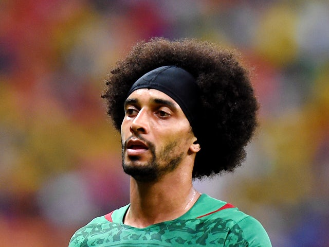 Cameroon's defender Benoit Assou-Ekotto walks on the pitch during the Group A football match between Cameroon and Croatia at The Amazonia Arena in Manaus on June 18, 2014
