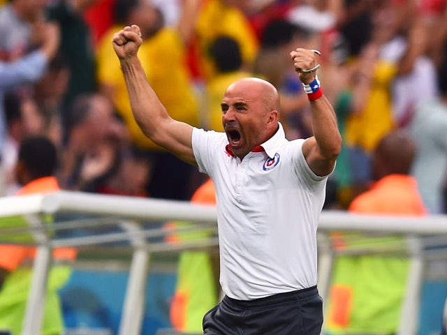 Head coach Jorge Sampaoli of Chile reacts after his team's first goal during the 2014 FIFA World Cup Brazil Group B match between Spain and Chile at Maracana on June 18, 2014
