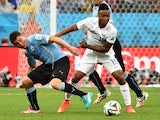 Uruguay's midfielder Cristian Rodriguez (L) vies with England's midfielder Raheem Sterling (R) during a Group D football match on June 19, 2014