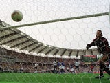 Brazil's Ronaldinho lobs England goalkeeper David Seaman on June 21, 2002.