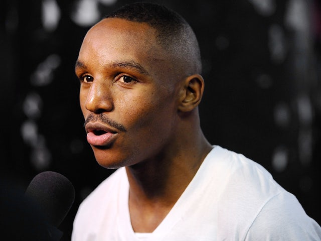 Devon Alexander talks with reporters during a training session in preparation for his upcoming fight against Shawn Porter at Gleason's Gym on December 3, 2013