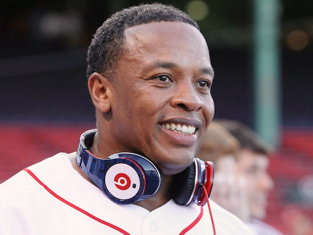 Producer and musician Dr. Dre is on the field before the Boston Red Sox take on the the New York Yankees on April 4, 2010