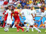 Eden Hazard of Belgium controls the ball against Madjid Bougherra of Algeria during the 2014 FIFA World Cup Brazil Group H match on June 17, 2014