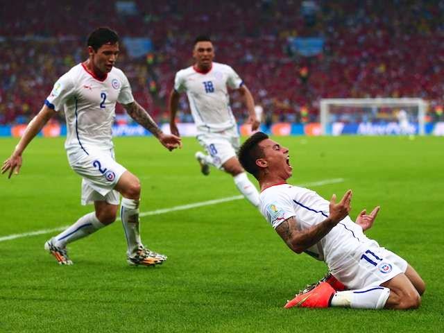 Eduardo Vargas celebrates scoring Chile's first goal against Spain on June 18, 2014.