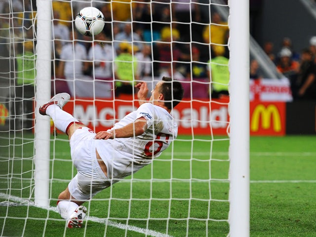 John Terry of England clears an effort from Marko Devic of Ukraine off the line during the UEFA EURO 2012 group D match between England and Ukraine at Donbass Arena on June 19, 2012