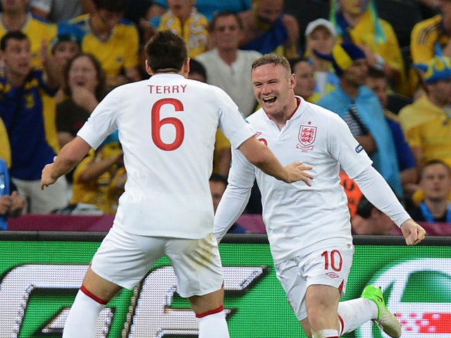 English forward Wayne Rooney and English defender John Terry celebrate after scoring during the Euro 2012 football championships match England vs Ukraine on June 19, 2012
