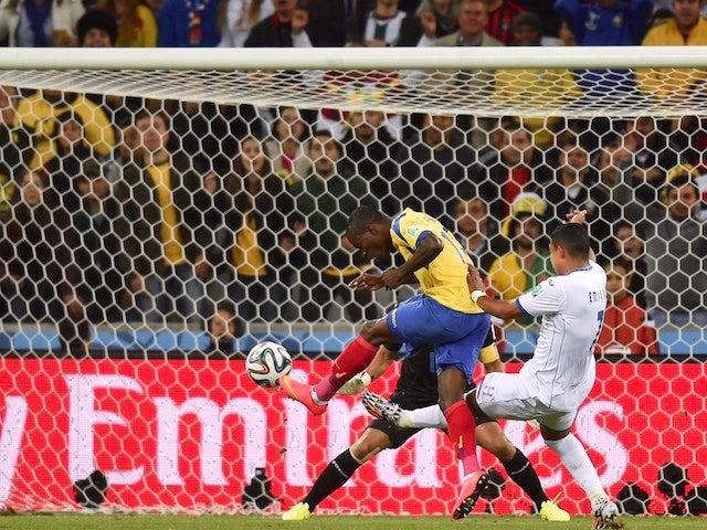 Ecuador's forward Enner Valencia (L) shoots and scores during a Group E football match between Honduras and Ecuador at the Baixada Arena in Curitiba during the 2014 FIFA World Cup on June 20, 2014