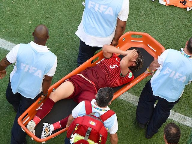 Portugal's Fabio Coentrao is stretchered off during his team's World Cup opener against Germany on June 16, 2014.