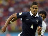 France's defender Raphael Varane runs with the ball during a Group E football match between France and Honduras at the Beira-Rio Stadium in Porto Alegre during the 2014 FIFA World Cup on June 15, 2014