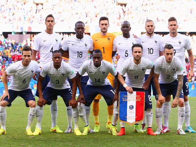 France players pose for a team photo during the 2014 FIFA World Cup Brazil Group E match between Switzerland and France at Arena Fonte Nova on June 20, 2014