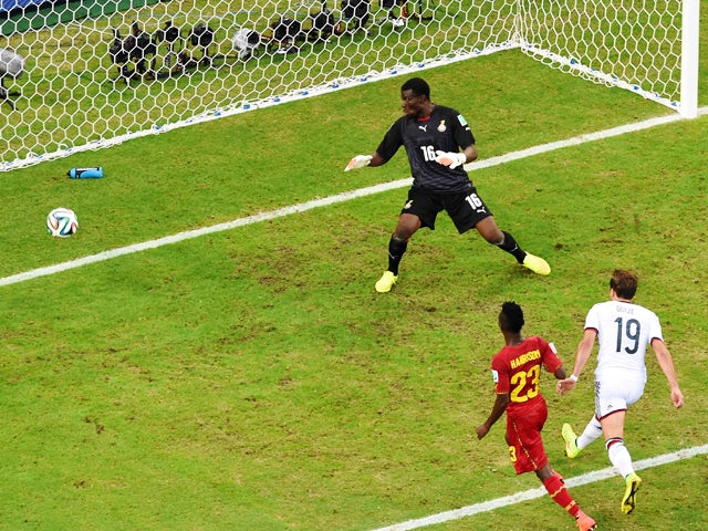 Mario Gotze of Germany scores his team's first goal past goalkeeper Fatawu Dauda of Ghana during the 2014 FIFA World Cup Brazil Group G match between Germany and Ghana at Castelao on June 21, 2014