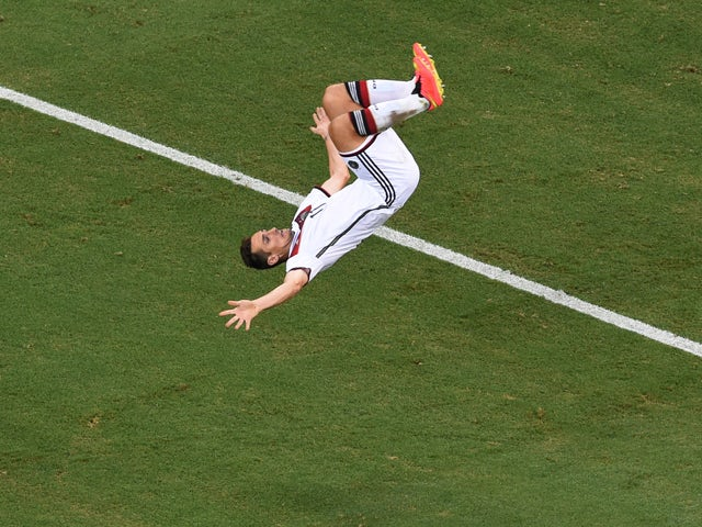 Miroslav Klose of Germany does a flip in celebration of scoring his team's second goal during the 2014 FIFA World Cup Brazil Group G match between Germany and Ghana at Castelao on June 21, 2014