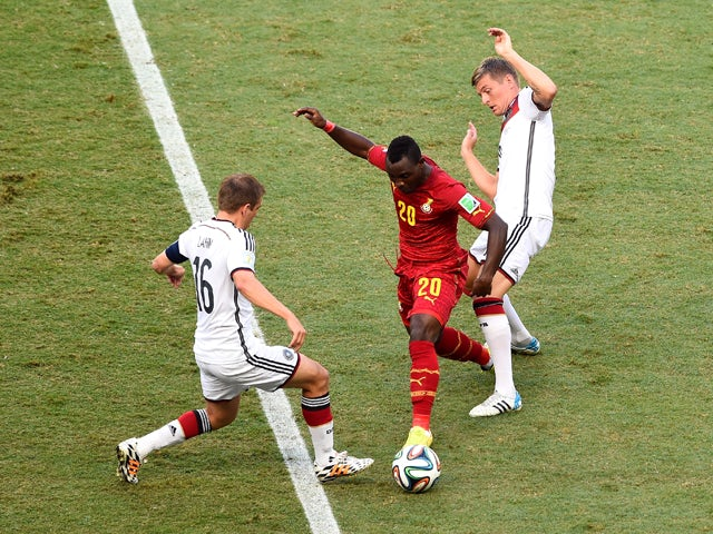 Kwadwo Asamoah of Ghana and Philipp Lahm of Germany compete for the ball during the 2014 FIFA World Cup Brazil Group G match between Germany and Ghana at Castelao on June 21, 2014