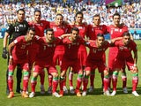 : Iran players pose for a team photo before the 2014 FIFA World Cup Brazil Group F match between Argentina and Iran at Estadio Mineirao on June 21, 2014