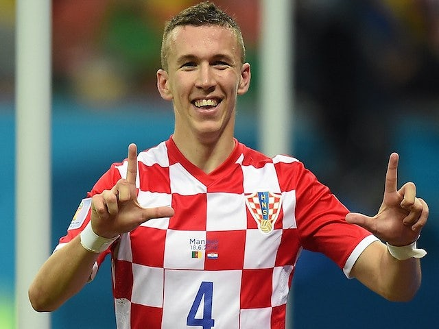 Croatia's midfielder Ivan Perisic celebrates after scoring during the Group A football match between Cameroon and Croatia at The Amazonia Arena in Manaus on June 18, 2014