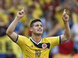 Colombia's midfielder James Rodriguez celebrates scoring during a Group C football match between Colombia and Ivory Coast on June 19, 2014