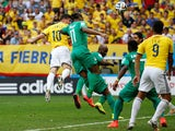 James Rodriguez of Colombia scores his team's first goal ona header against Didier Drogba of the Ivory Coast during the 2014 FIFA World Cup  on June 19, 2014