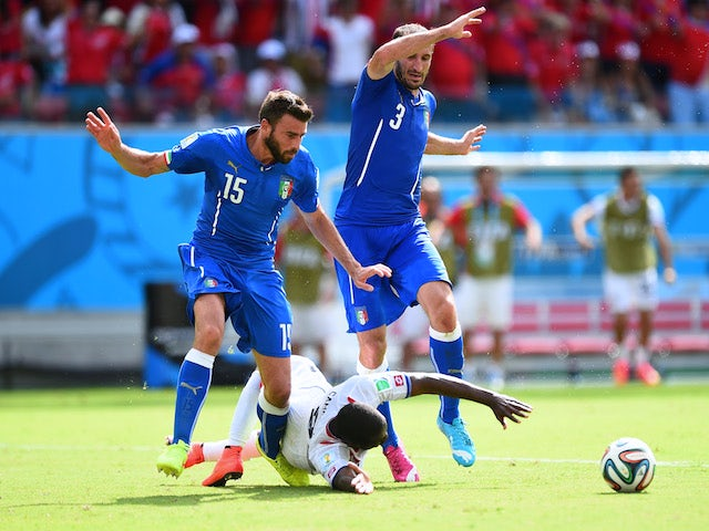 Joel Campbell of Costa Rica falls after a challenge by Giorgio Chiellini (L) and Andrea Barzagli of Italy during the 2014 FIFA World Cup Brazil Group D match on June 20, 2014