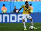 Colombia's midfielder Juan Fernando Quintero prepares to kick the ball to score his team's second goal during the Group C football match on June 19, 2014