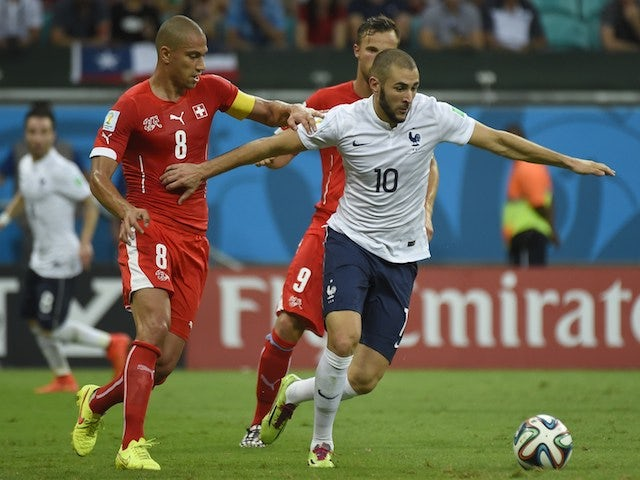 France's forward Karim Benzema (front R) vies for the ball with Switzerland's midfielder Gokhan Inler on June 20, 2014