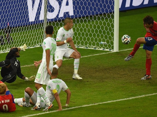 South Korea's forward Koo Ja-Cheol (R) kicks the ball to score his team's second goal during the Group H football match against Algeria on June 22, 2014