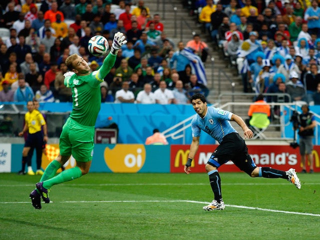 Luis Suarez of Uruguay scores his team's first goal past Joe Hart of England during the 2014 FIFA World Cup Brazil Group D match on June 19, 2014