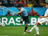 Luis Suarez of Uruguay scores his team's second goal against Gary Cahill of England during the 2014 FIFA World Cup Brazil Group D match  on June 19, 2014