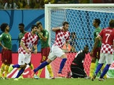 Croatia's forward Mario Mandzukic (C) celebrates his goal during a Group A football match between Cameroon and Croatia in the Amazonia Arena in Manaus during the 2014 FIFA World Cup on June 18, 2014